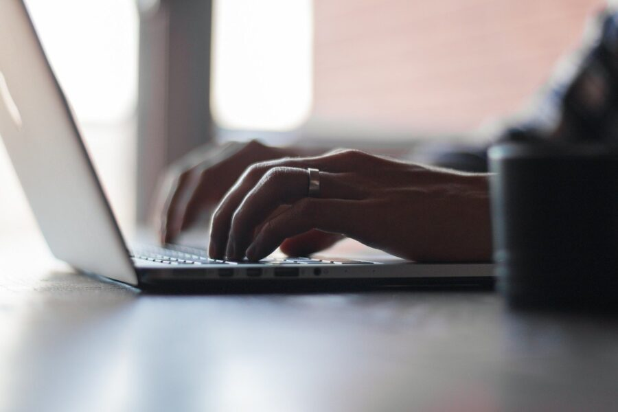 Image of a nursing home abuse attorney typing on a laptop, representing the experience of Brewer & Giggenbach, PLLC attorneys in fighting for your loved one's rights.