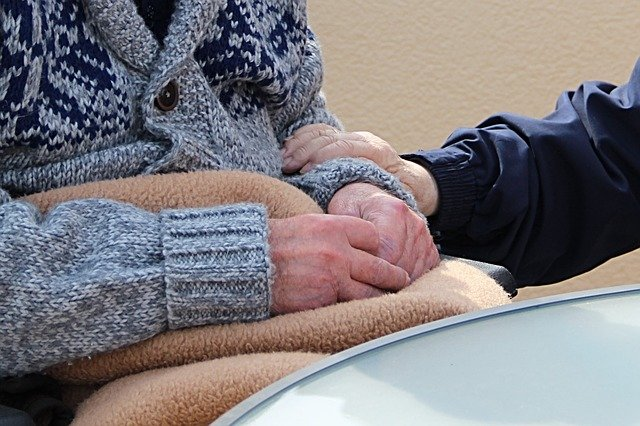 Image of a Morgantown nursing home abuse attorney comforting an elderly person in a wheelchair, representing the experience of Brewer & Giggenbach, PLLC attorneys in fighting for your loved one's rights.