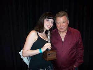 """Deena Roth, RunnerUp at the 1st Annual Dragon Con Miss Star Trek Universe Pageant in 2010, here with William """"Captain James T. Kirk"""" Shatner and her trophy which he signed at a subsequent 2011 Star Trek Conventionin Nashville."""
