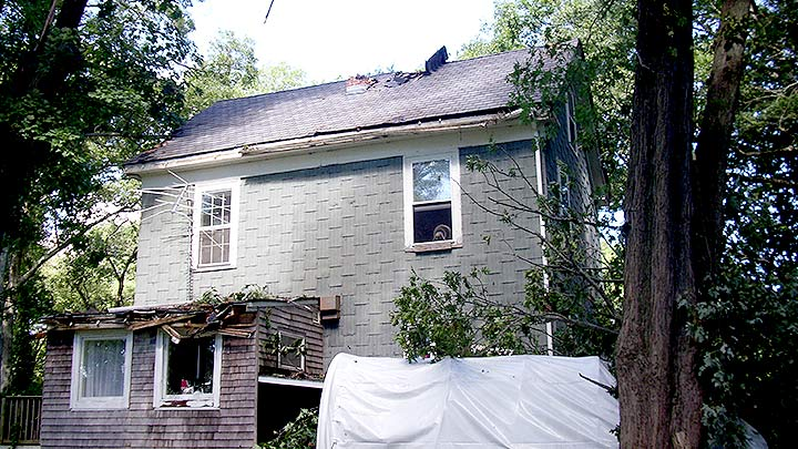 Exterior View of Damaged Roof