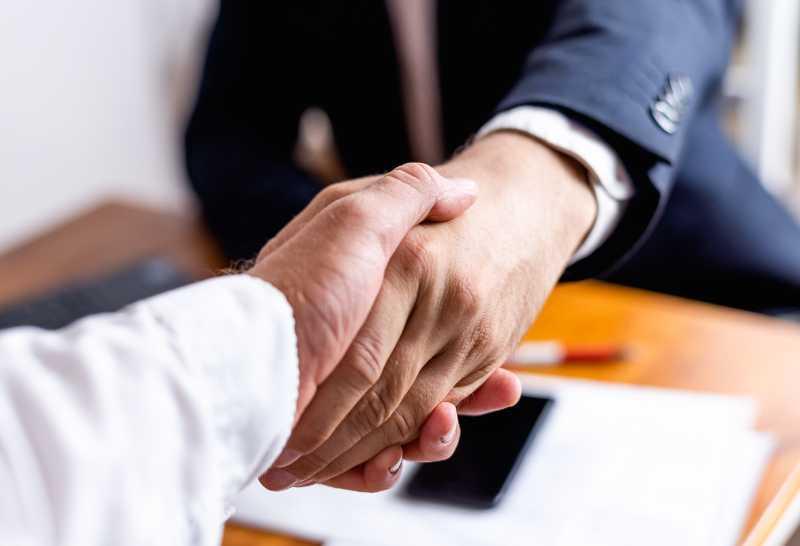 bigstock-Businessman-Handshake-Close-Up-379088089 (1)