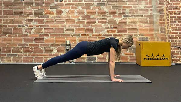 Standard push up with proper form in upper position