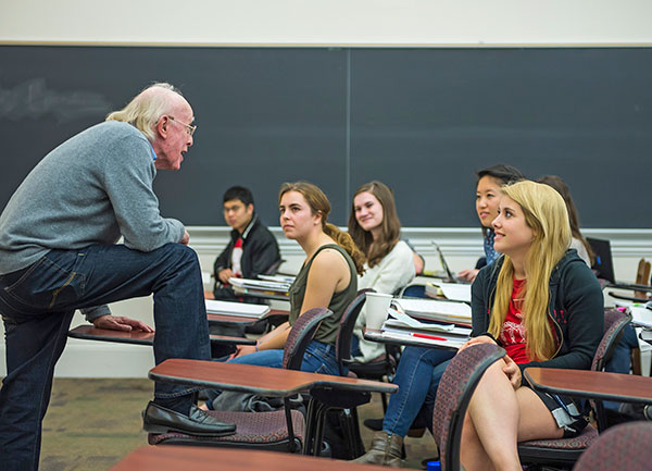 Dennis Huston commands the classroom stage during a spring semester course.