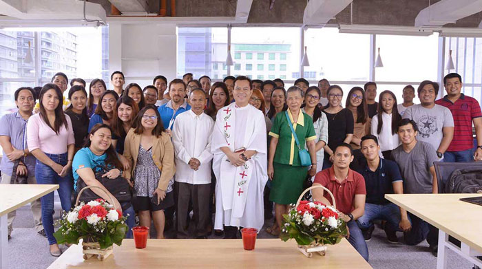 Team portrait during our office blessing. Admin, staffs, project managers, analysts, developers, programmers, QAs, technical writers, and SEO specialists gathered together.