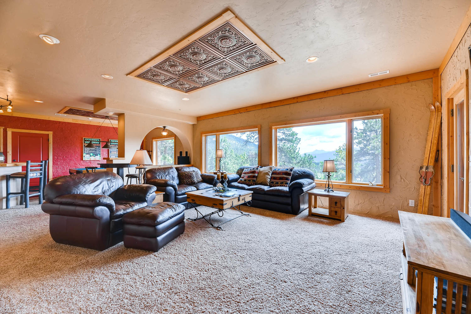 The lower level living room is comfy and an awesome hangout area.