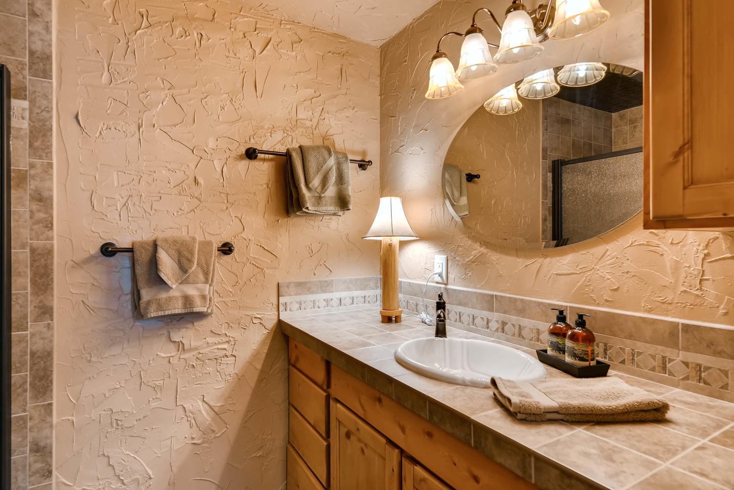 The lower level en suite bath has a large vanity and shower.