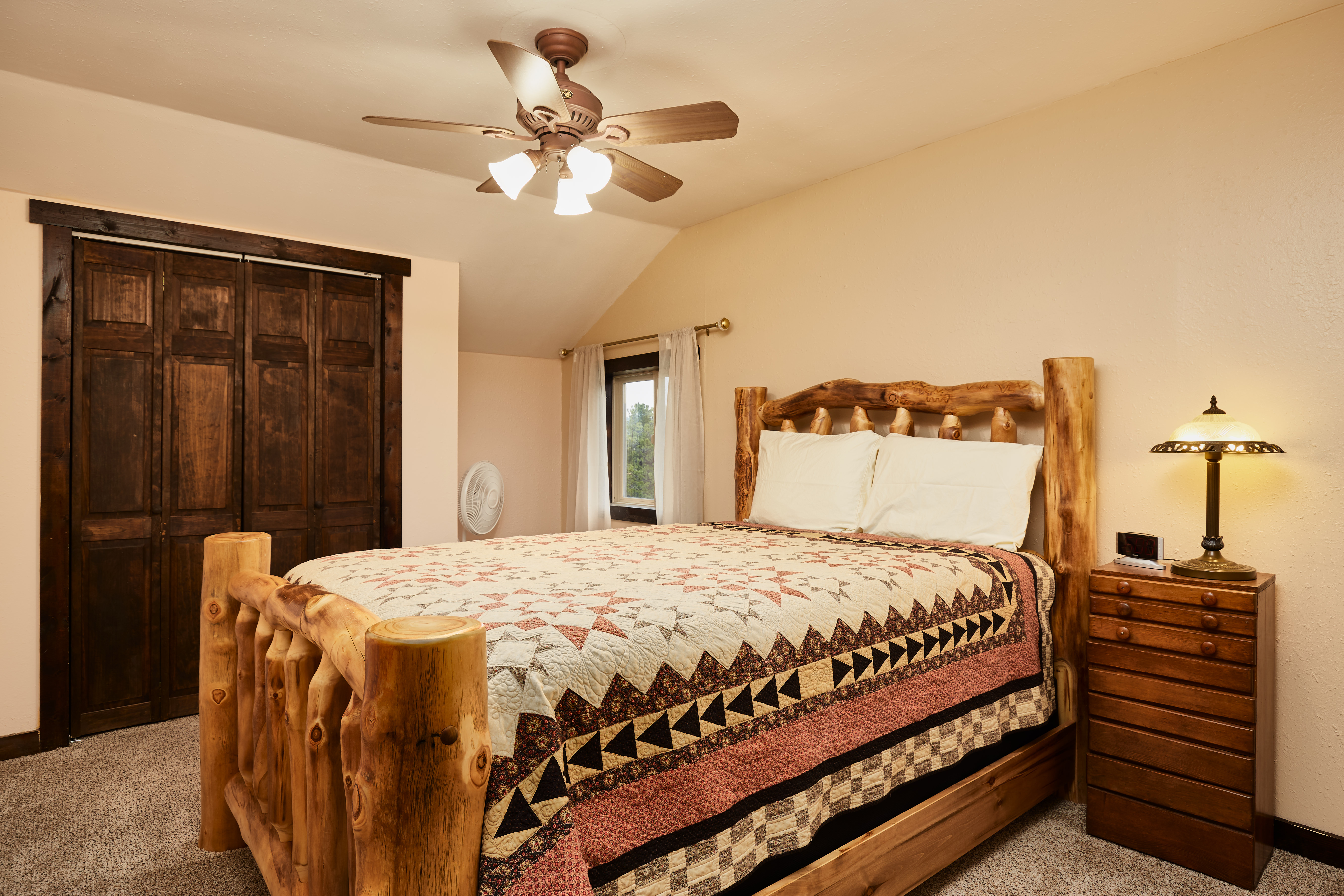 The second upstairs bedroom has a queen bed.