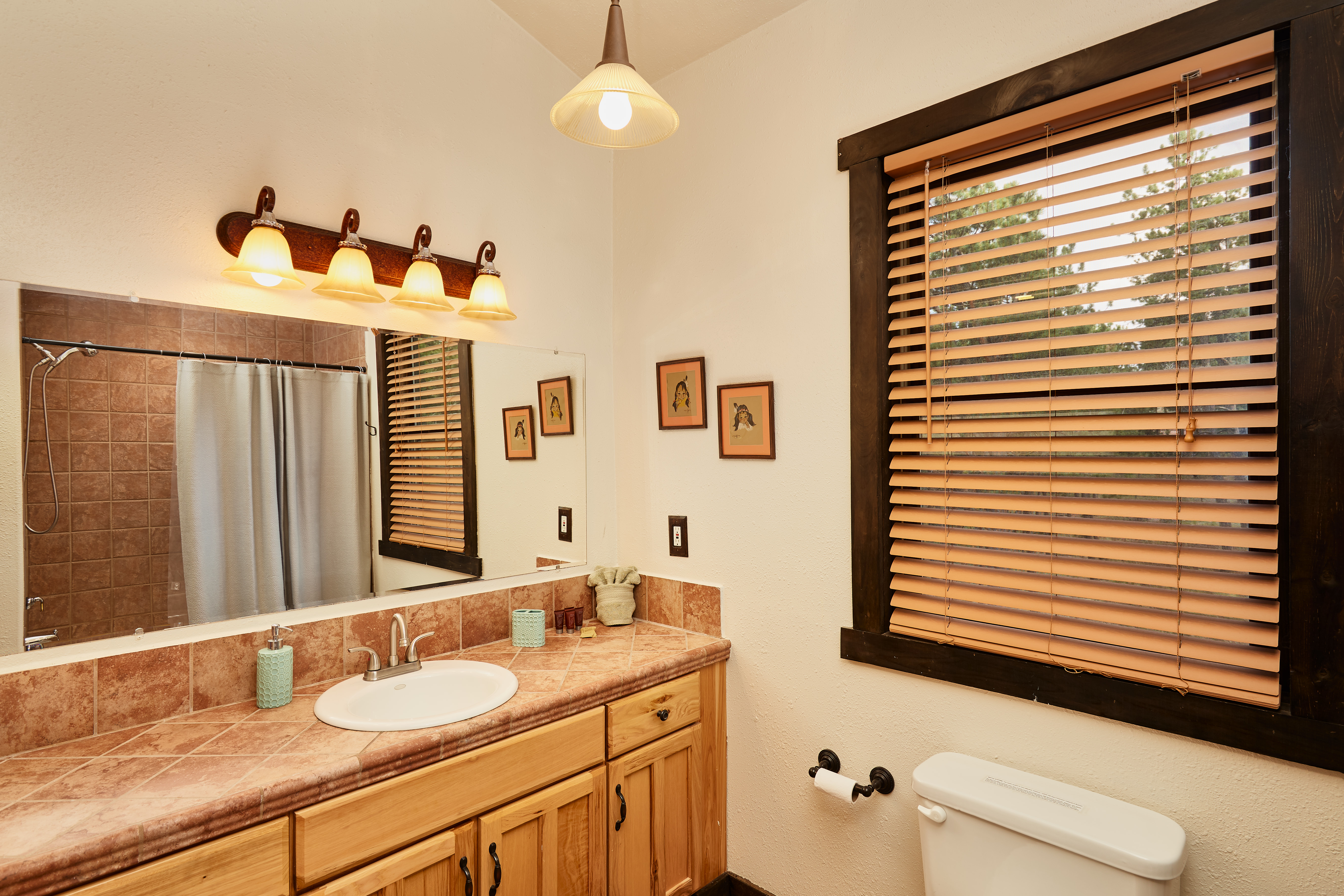 The upstairs bedroom has a large vanity.