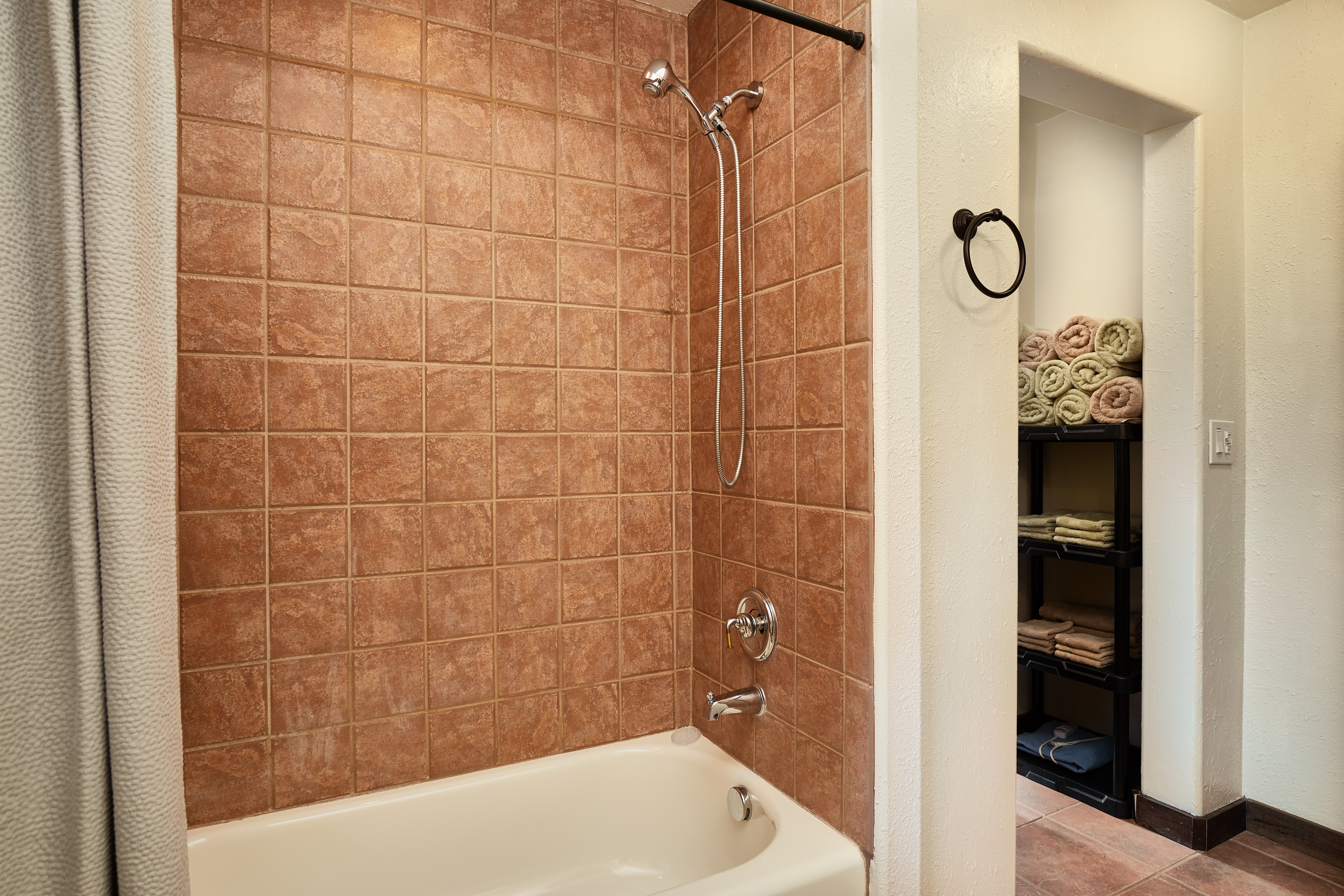 The upstairs bathroom has a shower/tub combo.