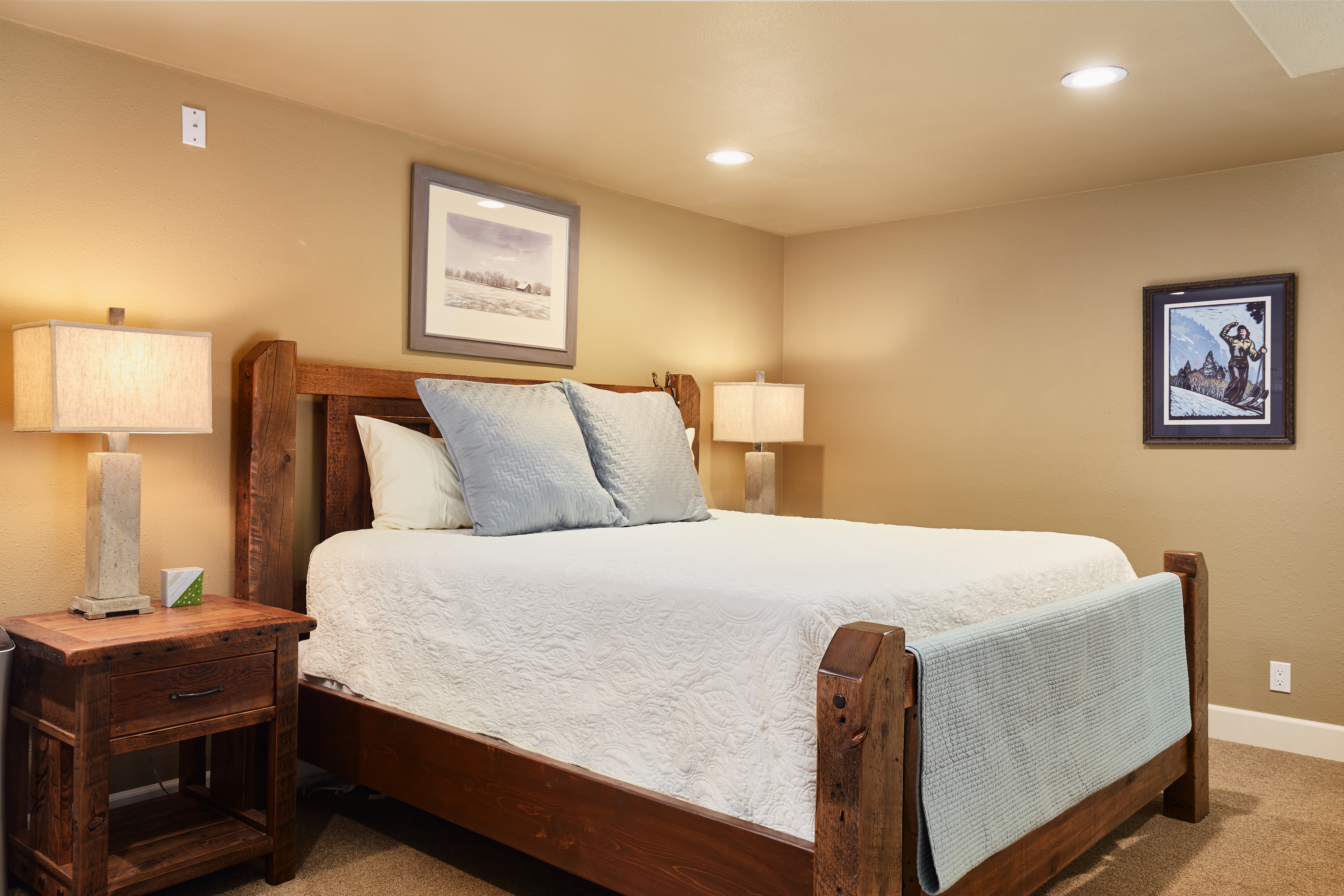 The downstairs master bedroom has a king bed and en suite bath.