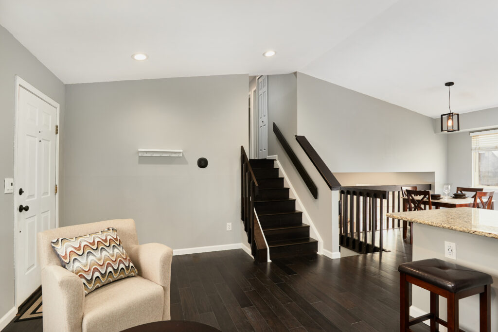 From the main level, you can go up to the bedrooms or down to the family room and TV room.