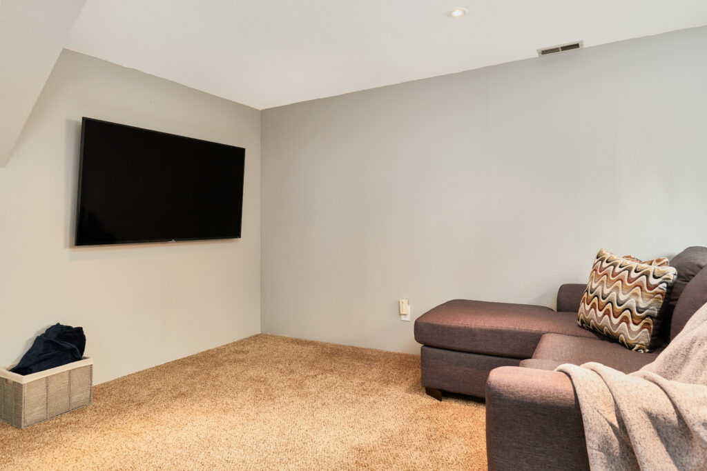 The TV room has an xbox and smart TV.