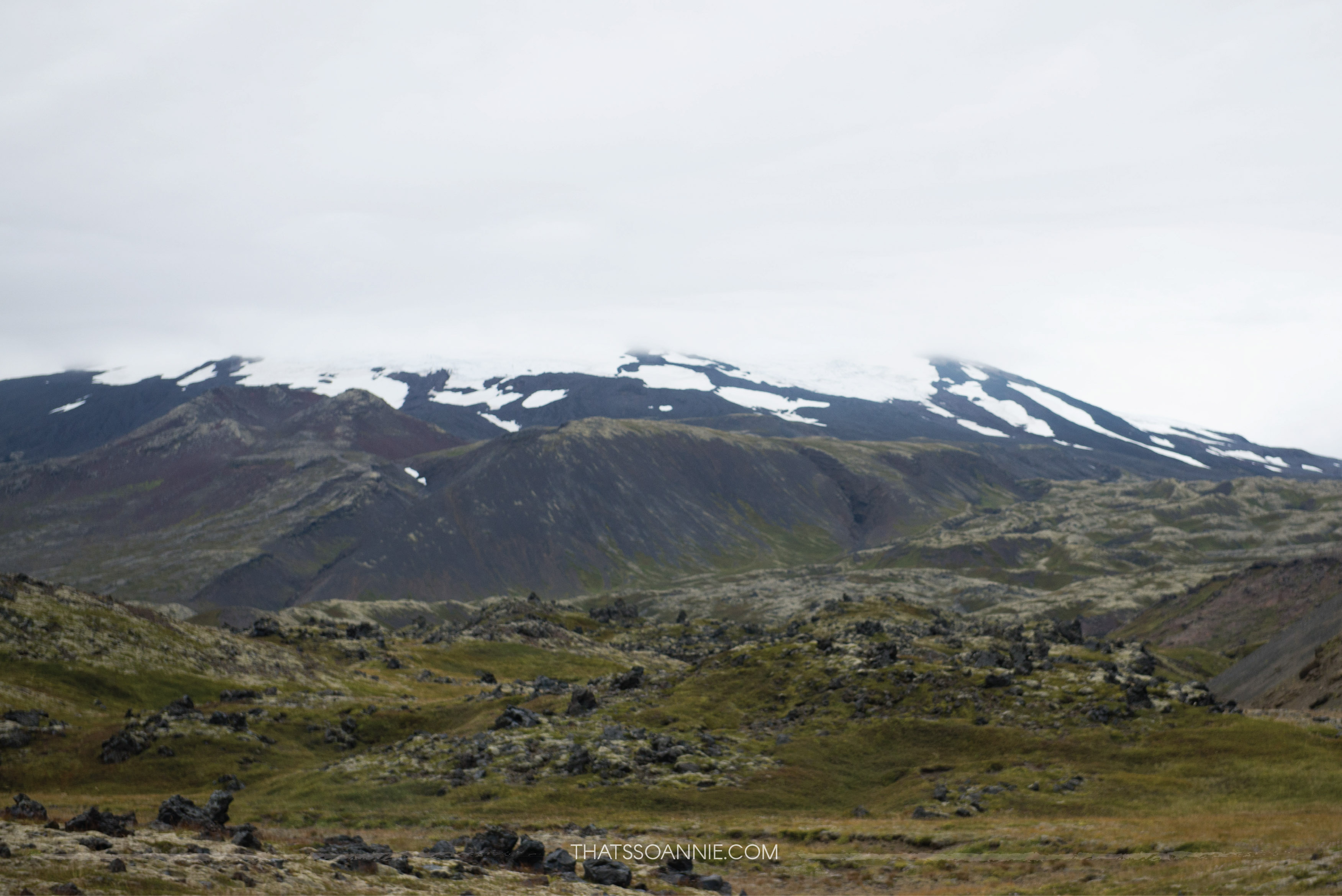 Snæfellsjökull surrounded by moss covered lava fields for miles on end | Exploring the Snæfellsnes Peninsula | Ring Road roadtrip, Iceland | www.thatssoannie.com