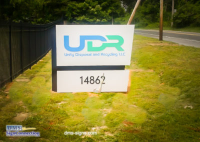 Aluminum Illuminated Quadrilateral Monument sign that reads UDR Unity Disposal and Recycling LLC