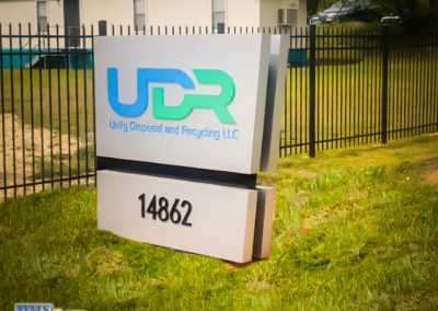 Isometric view. Illuminated Monument sign that reads UDR Unity Disposal and Recycling LLC