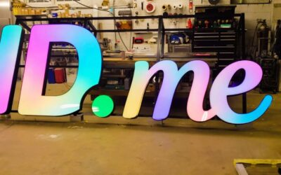 RGB Illuminated Channel Letters Installed With Custom Bracket On High Rise Building In McLean VA