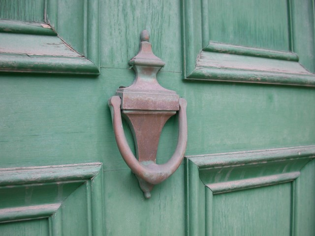 green door with old knocker