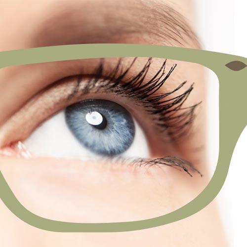 Vision Ad closeup of blue eye behind glasses