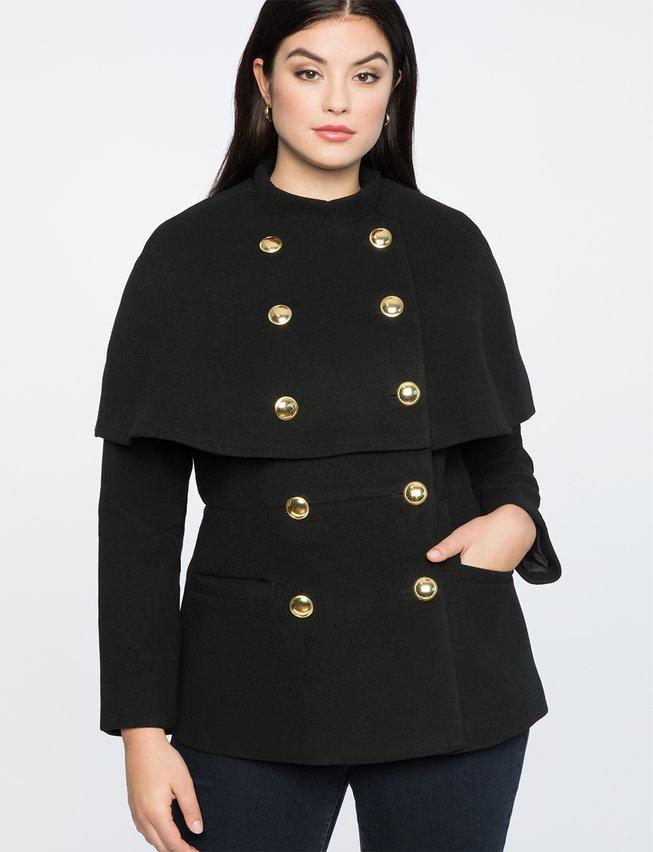 woman in cape jacket