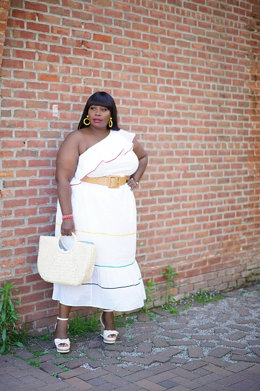 Lane Bryant spring dresses. Stylish Curves in a white one shoulder ruffled hem dress with wedges and a straw bag