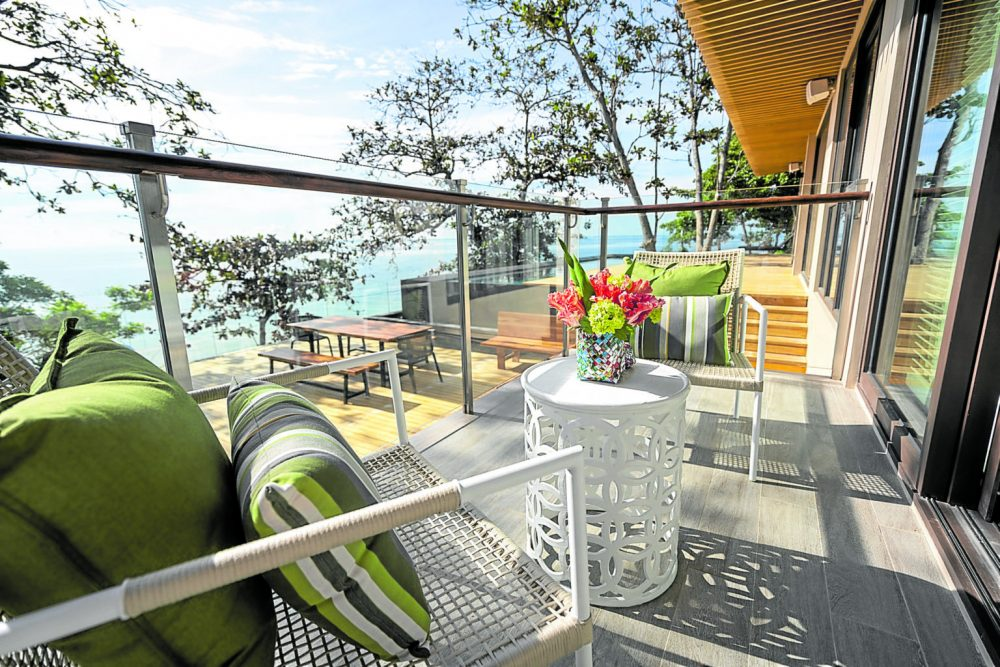 the view from the balcony in aruga resort and residences