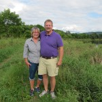 Tim & Flora Hurteau on their conserved land in Fairfax.