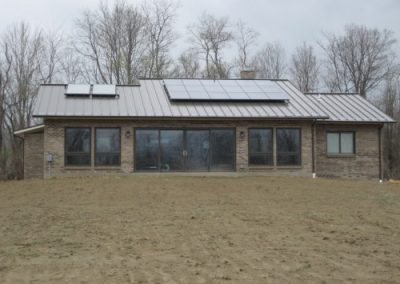 Panels on a newly constructed house with a metal roof