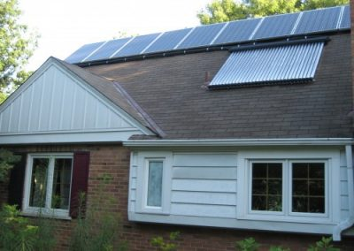 The lower set of panels heats the water for the household