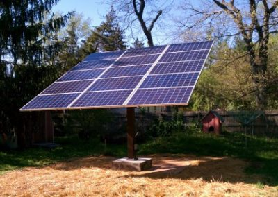Solar panels on pole mount system. A handcrank moves the panels to maximize efficiency with seasons