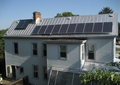 Schenk Residence with panels attached to an aluminum roof