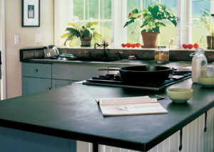 Vermont Soapstone countertops give this kitchen it's classic farmhouse look.
