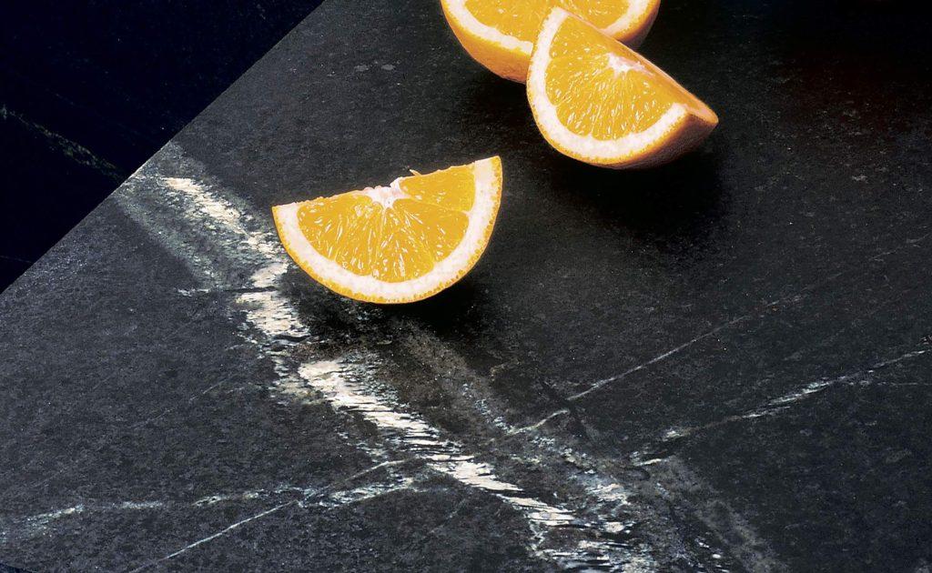 orange wedges on a Vermont Soapstone kitchen counter