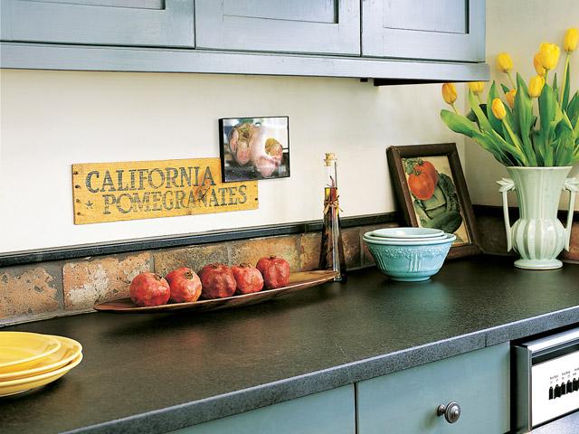 Beautiful kitchen featuring Vermont Soapstone custom countertops.
