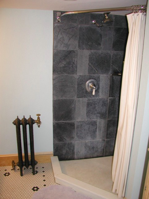 Vermont Soapstone tiles in the shower are elegant and impervious to water.
