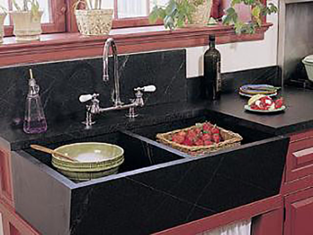 Rinsing strawberries in a Vermont Soapstone Windsor sink