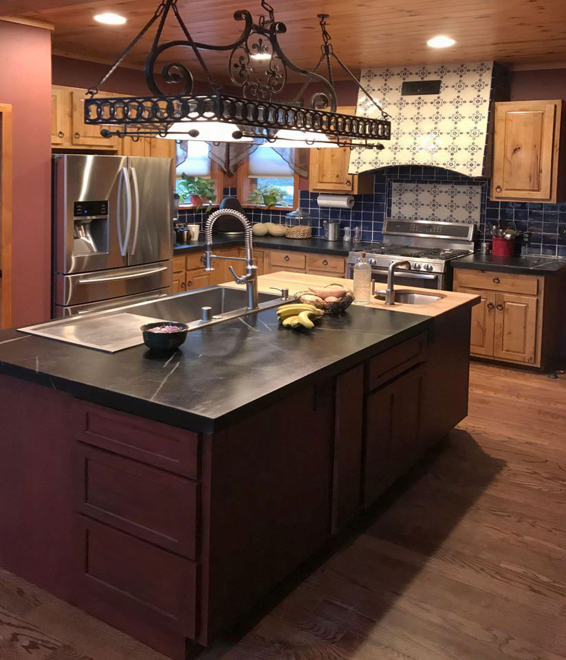 Vermont Soapstone combined with butcher block on an oversized kitchen island.
