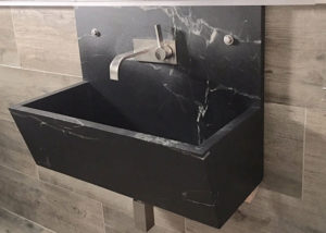 Custom wall lavatory shows how Vermont Soapstone can look great in a modern style bathroom.