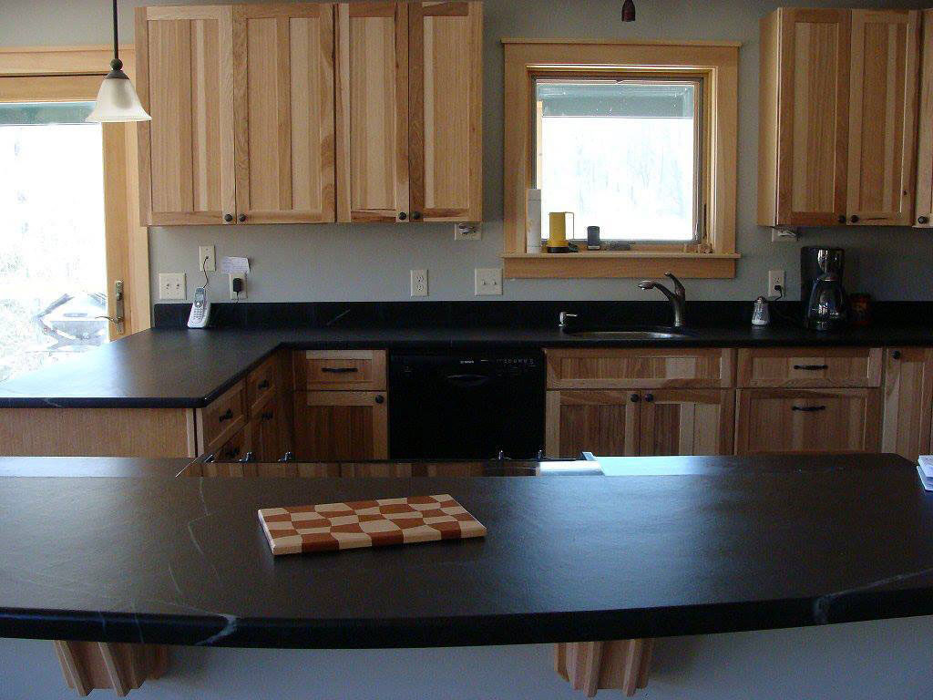 Vermont Soapstone can be worked like wood to create interesting custom shapes like this curved island top.