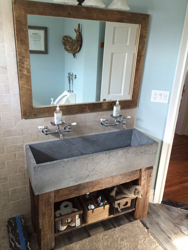 Unique extra-wide Vermont Soapstone lavatory fits perfectly in this rustic bathroom.