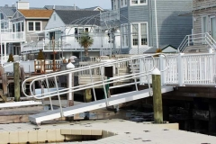 Gangways and Fixed Piers - Custom gangway with roller to allow movement with the tides.