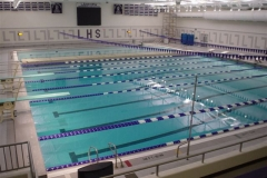 Here EZ Dock is configured to with a walking platform in a swimming pool to allow judges and coaches to travel next to swimmers.
