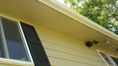 Wall with Wood Siding, Shutter, Window to Side, Soffit Overhang Above