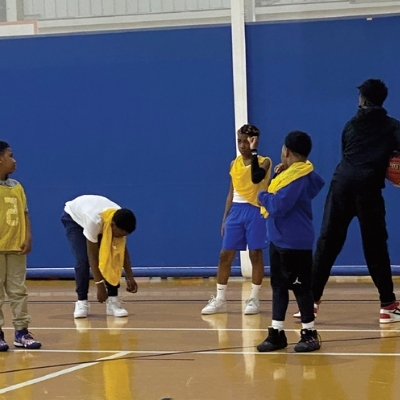 a group of young men playing basketball
