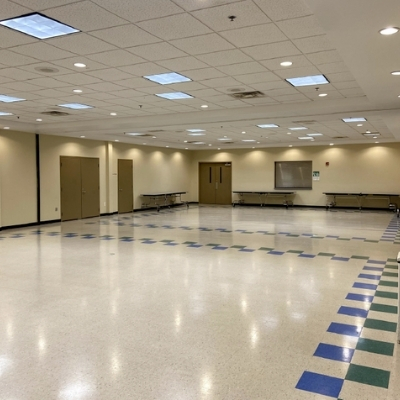 a brightly lit event room available for rent at the palw