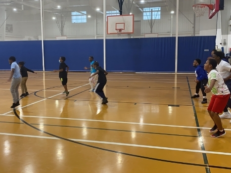 a group of young boys and girls workout in the gym