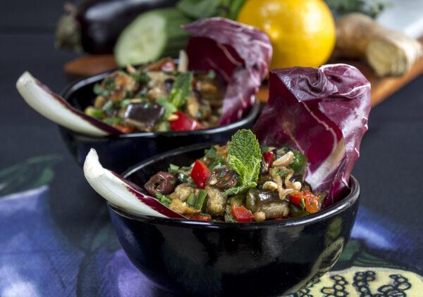 Roasted Eggplant Salad in black glass bowls with a Meyer Lemon-Ginger Dressing