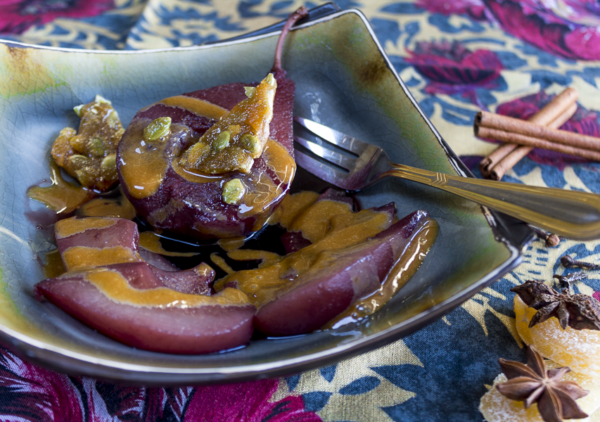 Spiced, beautiful pears swimming in a ruby syrup with a creamy zabaglione custard - perfect for the holidays
