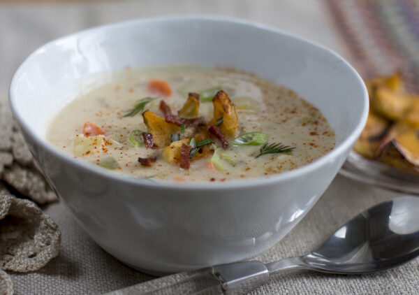 """THE soup to fuel you through winter! Bake potatoes, use the flesh for the soup, skins for """"croutons."""" Healthy and lightened up with broth, milk and loaded with vegetables."""