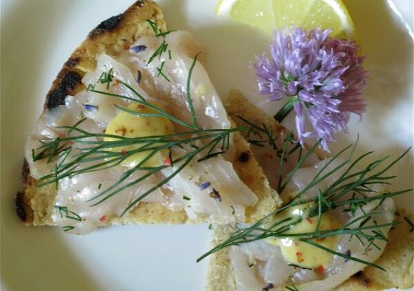 Flavor the flesh of Wild Caught Alaskan Salmon with Lavender, Dill, Vodka and Pink Peppercorns. An elegant gravlax that also can be prepared with any fresh salmon.