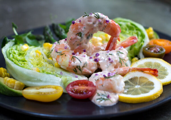This fresh, seafood-rich trendsetter recipe of the early 20th century takes on a modern flair with Fresh (not frozen) Pink Shrimp and a Zippy Louis Sauce